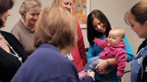 Ashleigh brings Peightyn in to see NICU staff who cared for her.