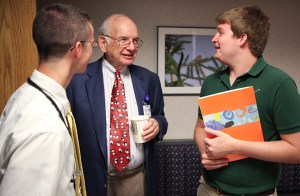 Dr. Stone (center) enjoys mentoring students who are interested in pursuing medicine.