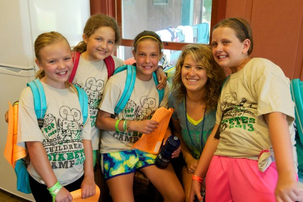 Lisa Broerman with kids who attended diabetes camp.