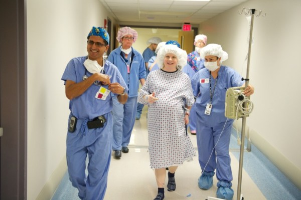 Ibrahim Farid, MD, and RNs Debbie Burgoyne, Carrie Gardiner accompany Angela to the delivery room