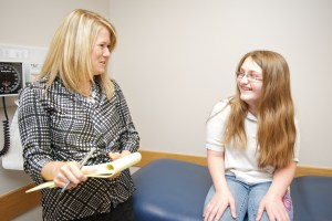 Lisa Broerman with a patient.