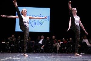 Megan Merril, cancer survivor, and her dance partner from University of Akron.
