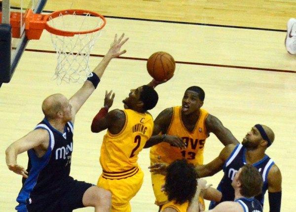 Kyrie Irving drives the basket. Flickr/Erik Drost