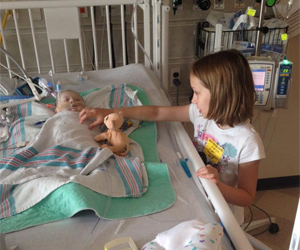 Harper big sister, Kaitlyn, checks on her the day she is admitted in the PICU.