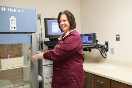 Kim Oldfield, RN, shows off a new addition to the Neurology department, a MedSelect cupboard that secures and automatically dispenses medicines.