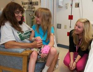 Katie Hixon talks with family before the sedation procedure.