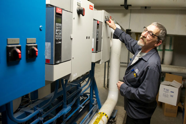 Tim Crowe checks on cleaning tubes in the Trane chillers in one of the hospital's mechanical rooms.