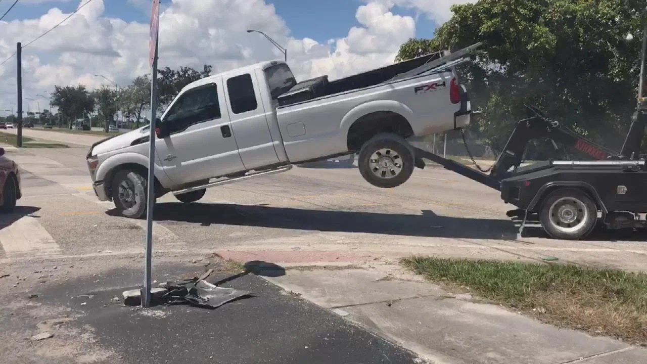 Tow Truck Man Tries To Drive Away In Truck As Its Being Towed