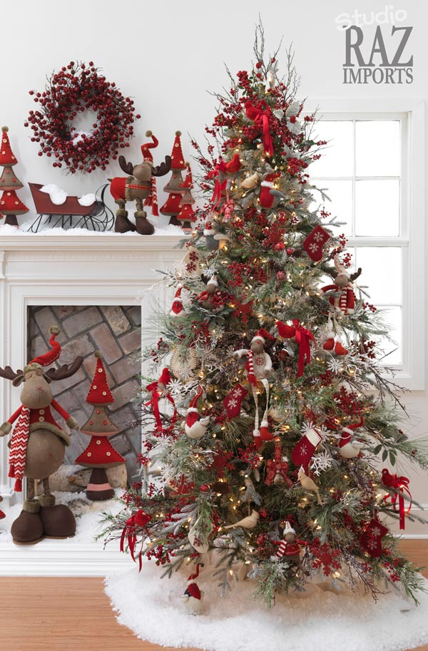 Christmas tree decorations ideas with red and white ornaments and snow