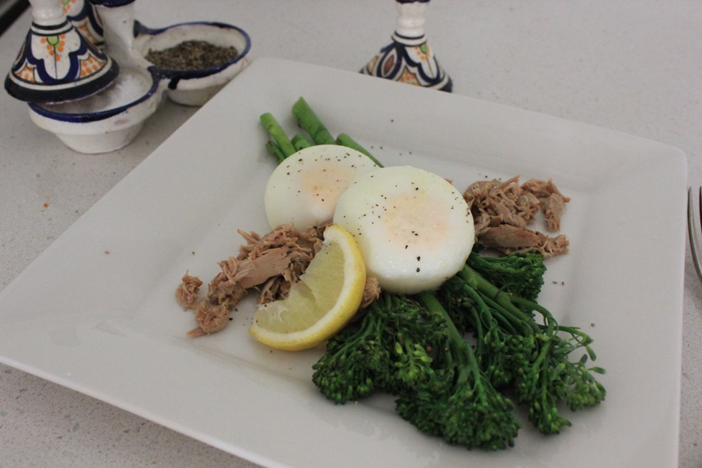 Poached eggs with lemon pepper tuna and broccolini