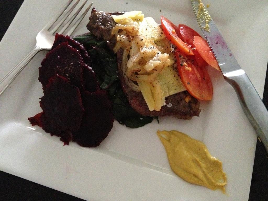 Wheat-free Open steak burger with cheese, onion, tomato, beetroot, beetroot leaves and mustard