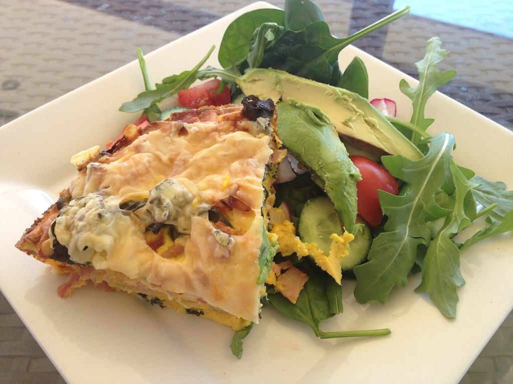 Cheese and bacon and spinach quiche