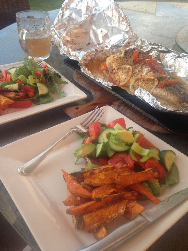Sweet potato fries, fish and salad