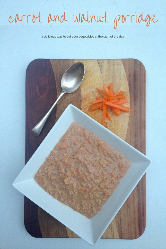 Carrot and walnut porridge in a bowl on a timber kitchen board