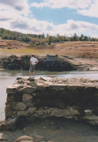 Walker, age 10, standing on the abutment of historic Rattlesnake Bar Bridge