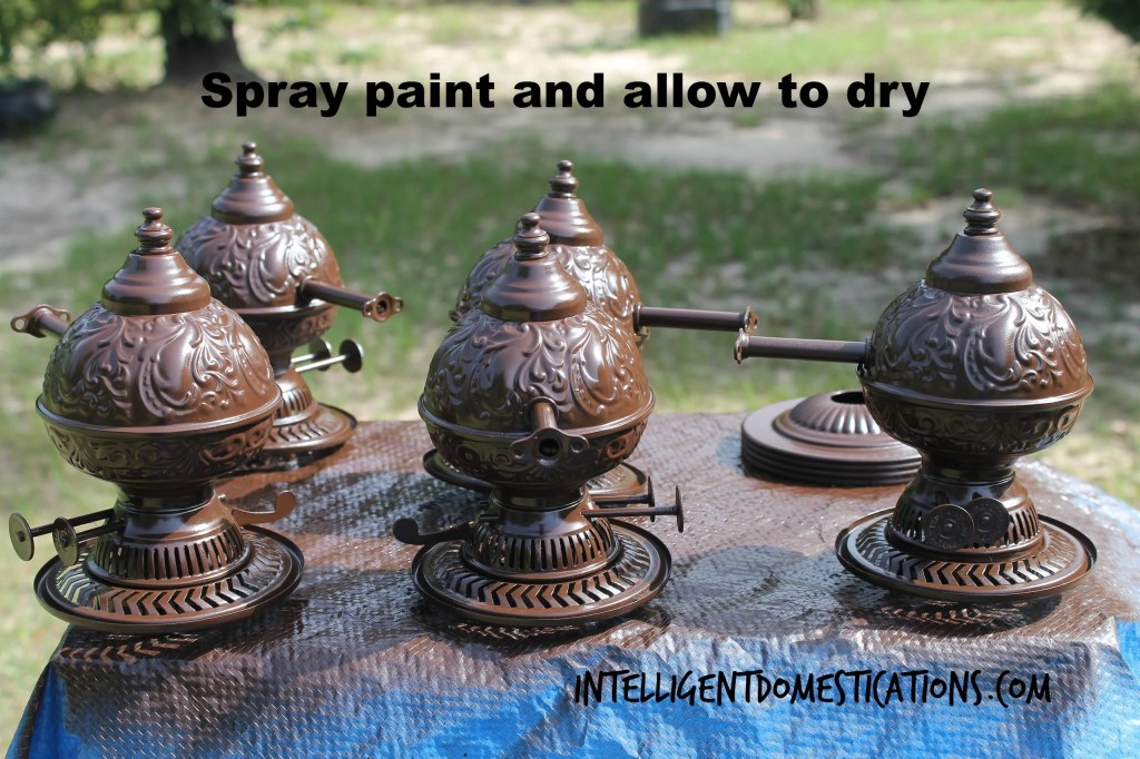 Spray paint the faux oil lamp pieces and allow to dry.intelligentdomestications.com
