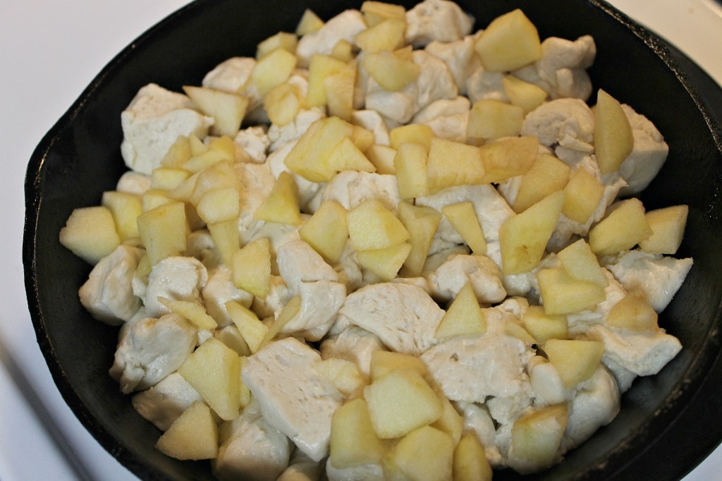 Place the biscuit pieces on top of the caramelized mixture then top with the remaining apples
