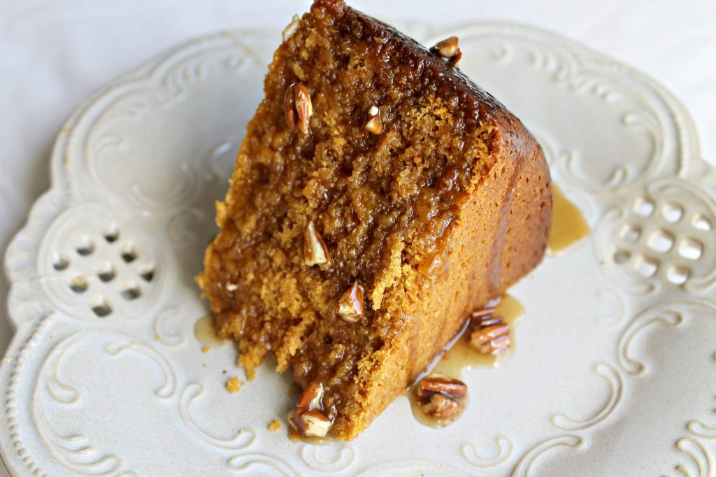 Crockpot Pumpkin Cake drizzled with Maple Pecan Topping. Find these ad more recipes at www.intelligentdomestications.com