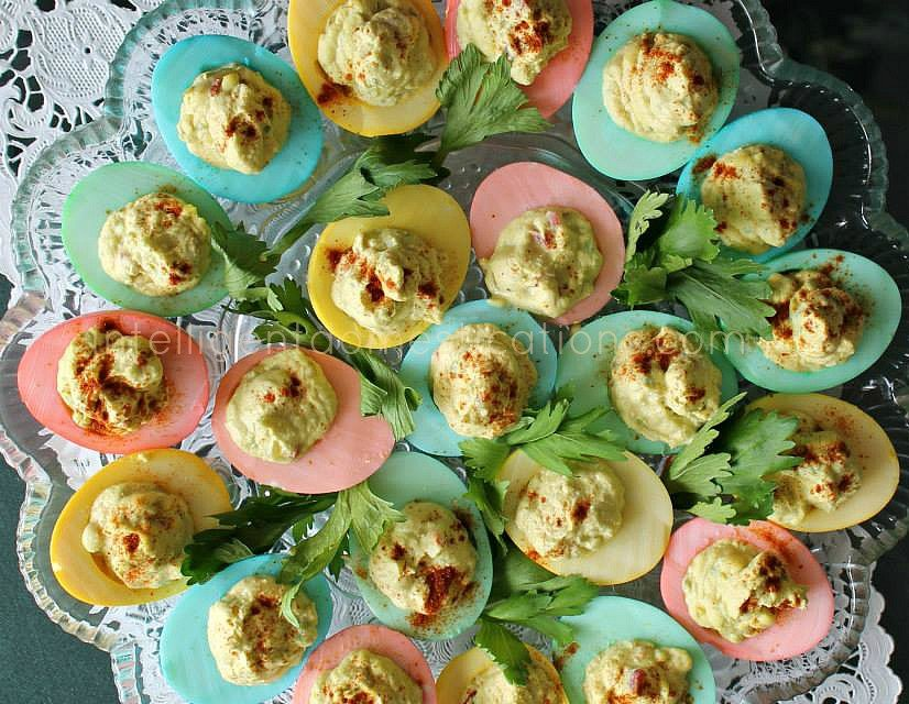 A plate full of pastel rainbow deviled eggs.intelligentdomestications.com