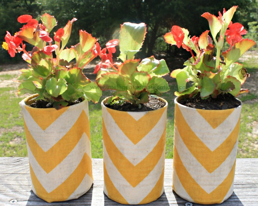 Mod Podged Chevron fabric covered cans become flower pots.www.intelligentdomestications.com
