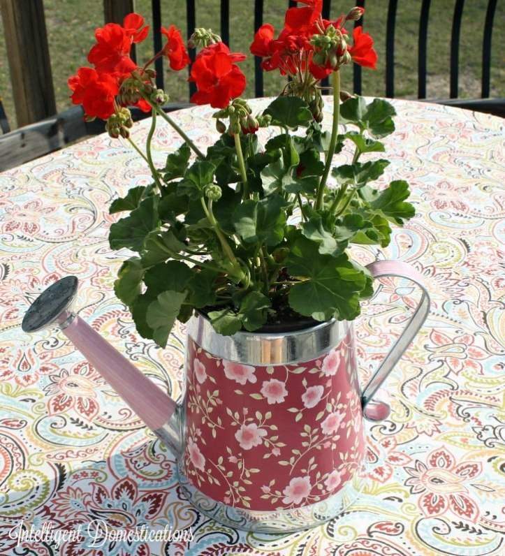 DIY DecorativeDIY Watering Can Flower Pot Centerpiece. an easy Mod Podge project.intelligentdomestications.com