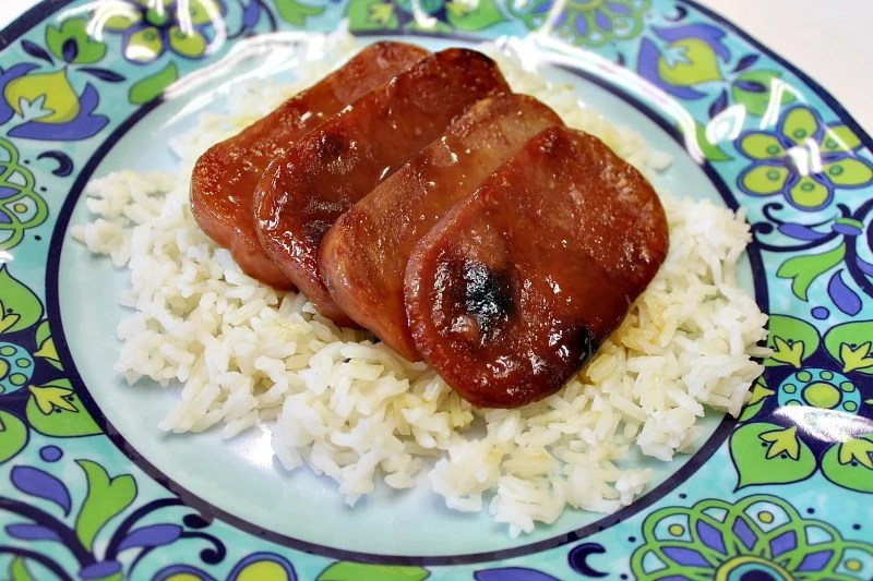Glazed Baked Spam is good served on a bed of rice. An affordable and tasty weeknight ham dinner.