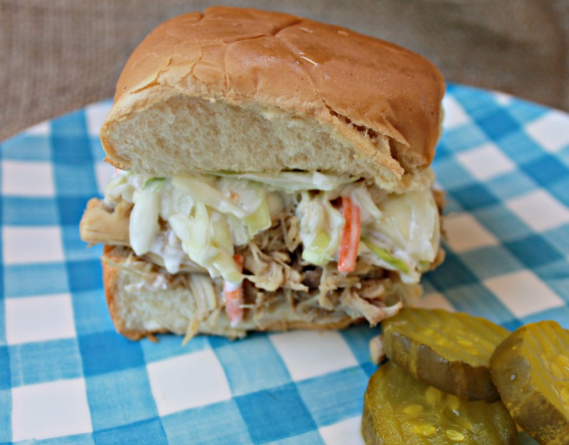 Ranch Chicken Sliders piled up with homemade creamy coleslaw and served with bread and butter pickles on the side