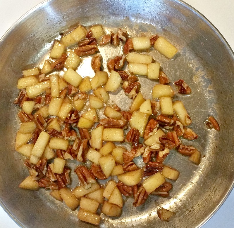 cook-cut-up-apples-and-pecans-in-the-skillet-just-long-enough-for-the-apples-to-become-tender