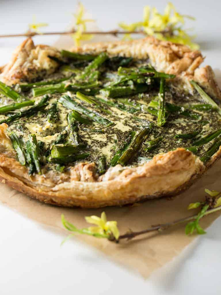 Fresh picked asparagus in a creamy filling  on top a light crispy puff pastry shell makes this easy Asparagus Tart so beautiful  and tasty that your friends will think you worked hours on preparing it.  It's a perfect quick appetizer or side dish for your spring  luncheons or dinners.