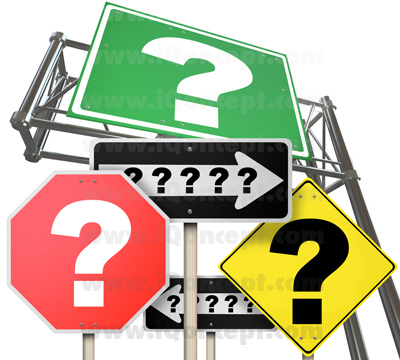 Many road signs featuring question marks symbolizing uncertainty