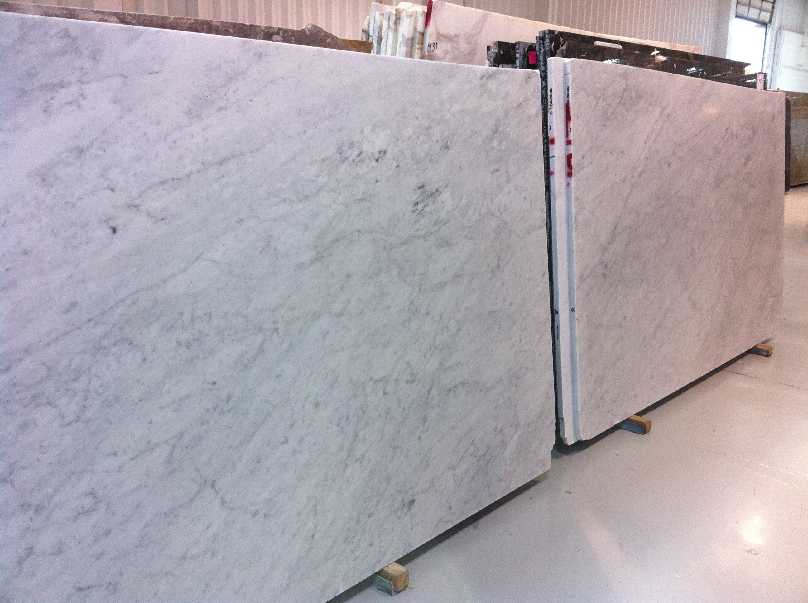 Engineered Stone Countertops Vs Granite What Looks Good With Carrara Marble Interiors For Families