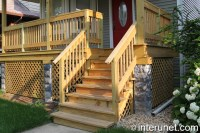 Front porch with wood railing
