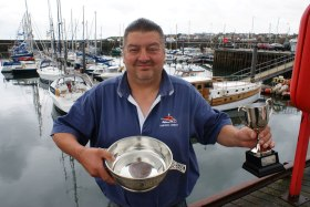 Mal Nicholson with trophies won by the Spider T at the Anstruther Muster 2011