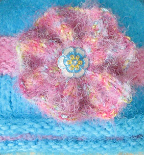 detail of free hat knitting pattern in bloom