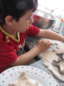 boy getting ready to make his shapes from the dough