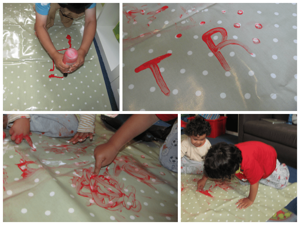 mark making with paint on oilcloth for messy play