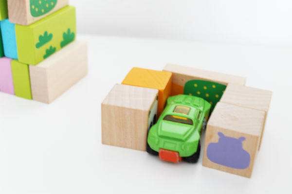 Making a car park with wooden blocks