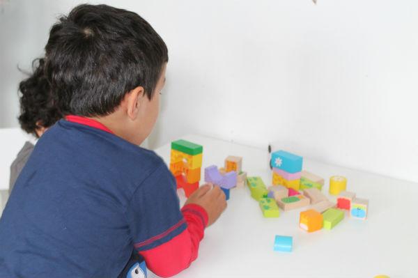 playing with Bigjigs Safari wooden blocks