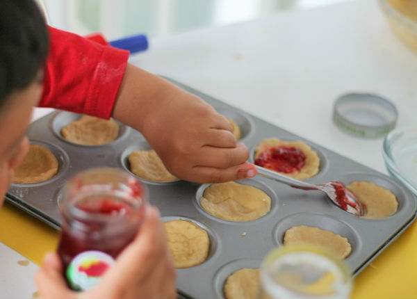 putting jam in the jam tart