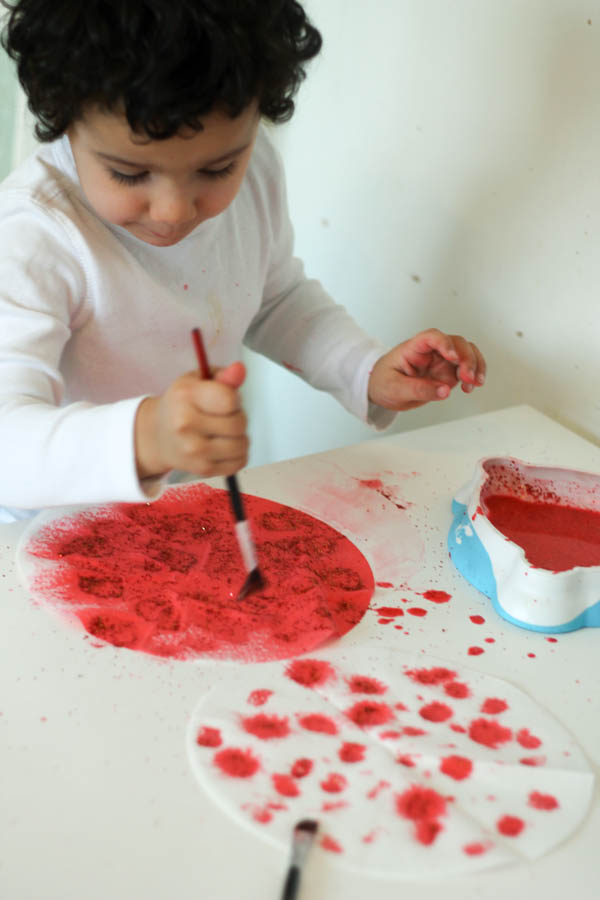 paint absorption process art with red and gold