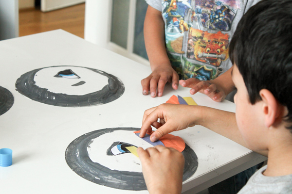 making paper plate puffins to go with Puffin Rock
