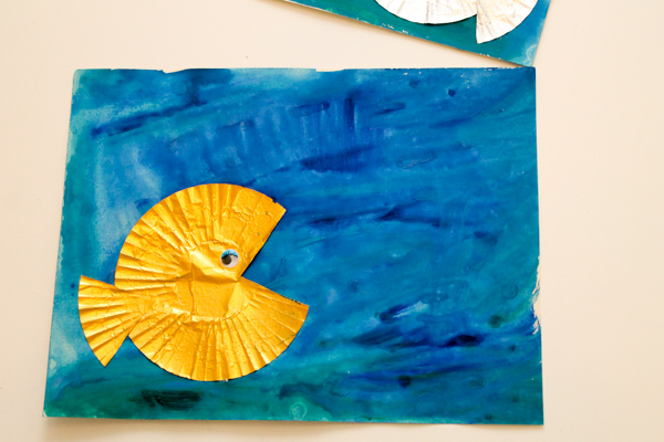 cupcake liner fish craft with watercolour ocean background