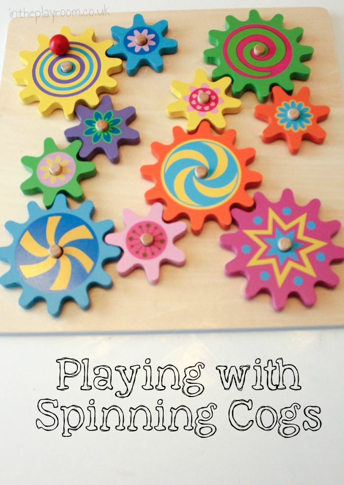 Playing with spinning toys. Simple and fun STEM toy for young children