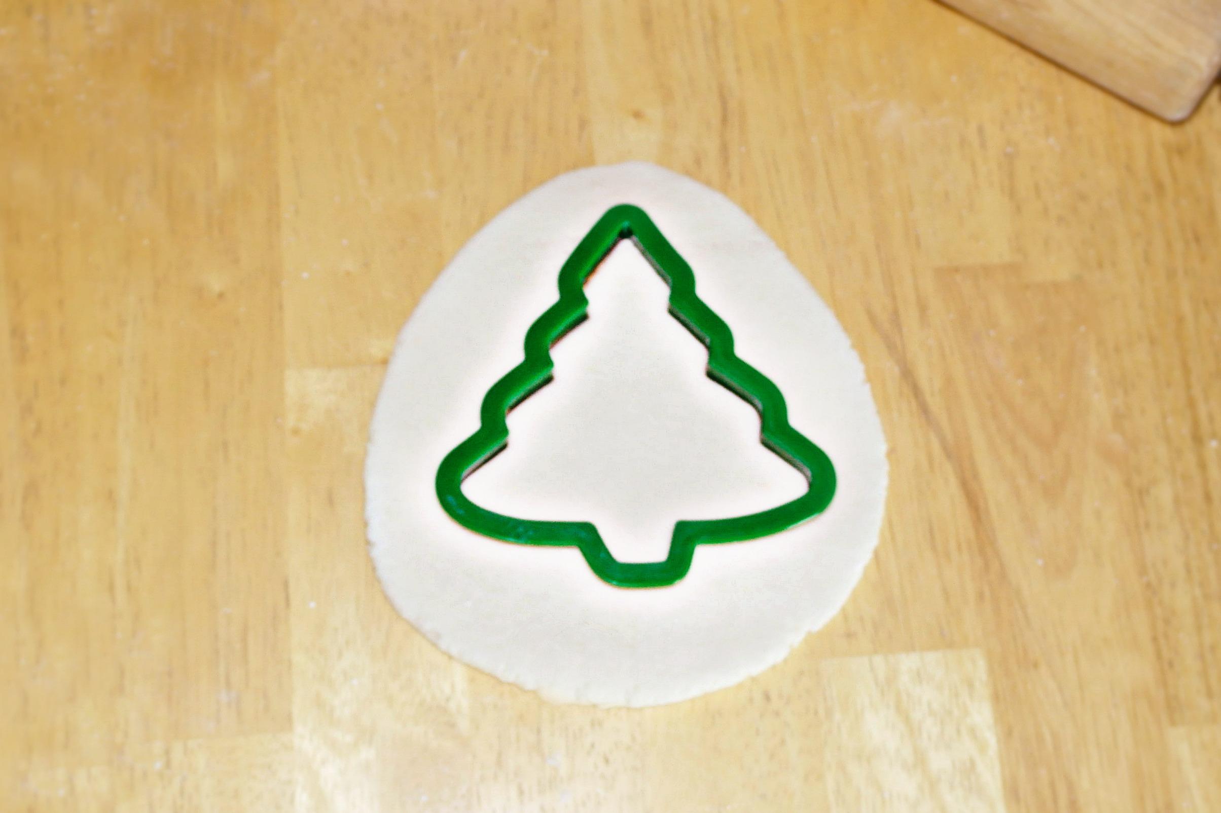 cutting out a salt dough christmas tree