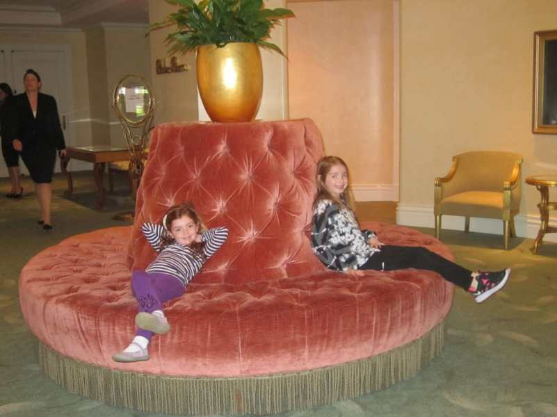 Girls lounges on the couches in the lobby