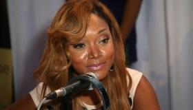 Mariah Huq speaking into a microphone