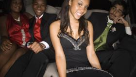 Multi-ethnic teenagers in limousine