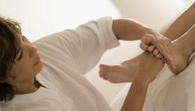 Close-up of a woman massaging a person's foot