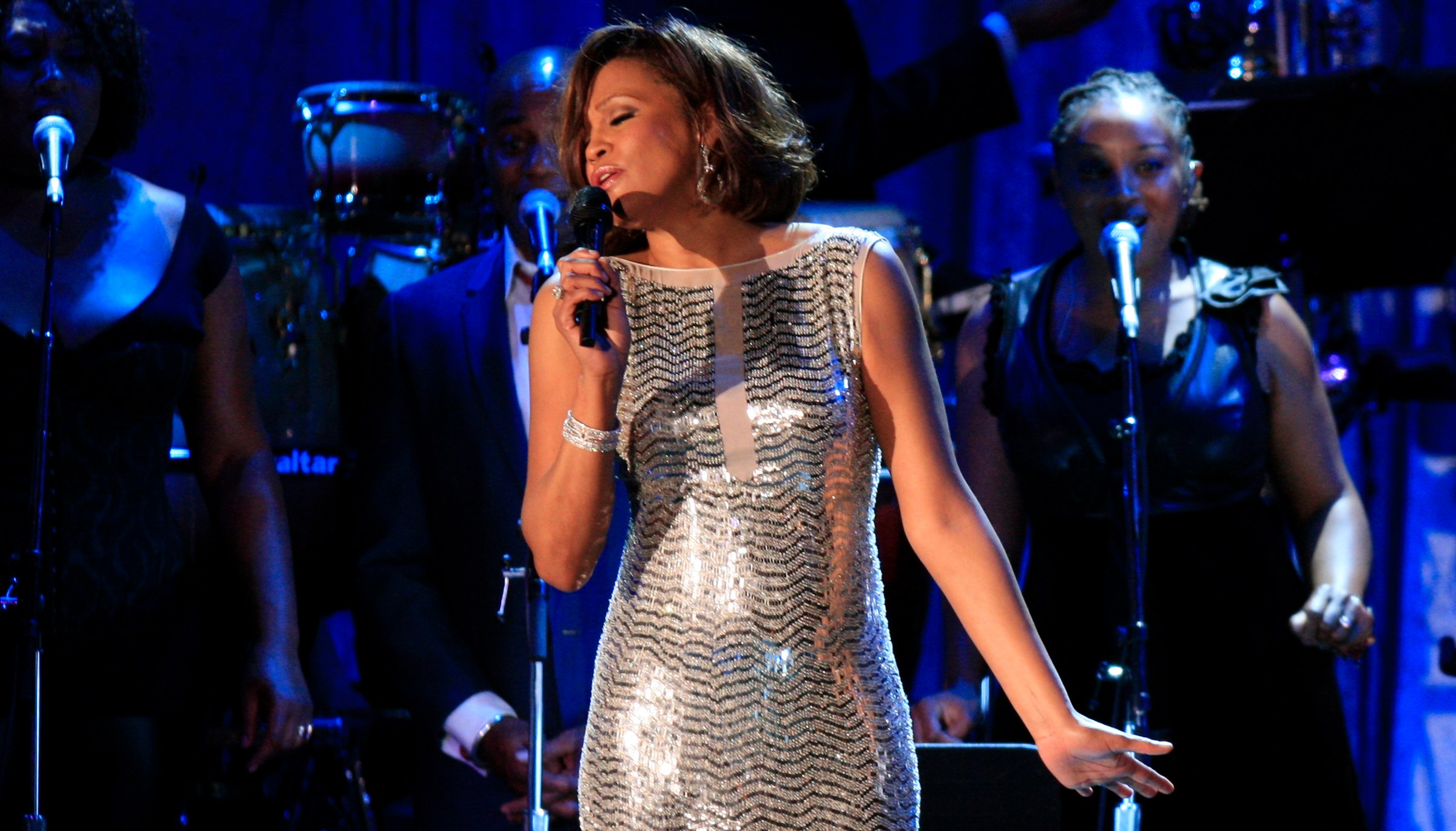 Singer Whitney Houston performs at the 2011 Clive Davis Pre–Grammy Gala and Salute to Industry Icon
