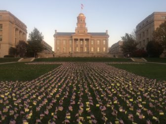 Small U.S. flags decorate the University of Iowa Pentacrest on Nov. 9 in observance of the Nov. 11 Veterans Day. Photo: Lyle Muller/IowaWatch